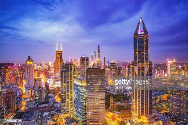 illuminated skyscrapers at night, china - image stockfoto's en -beelden