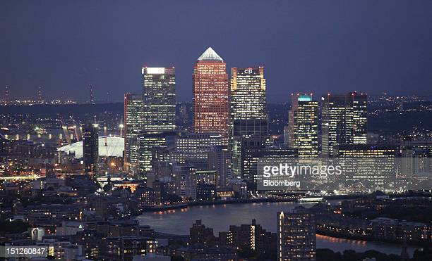 Illuminated skyscrapers in the Canary Wharf business district are seen from the Heron Tower on the skyline of London UK on Tuesday Sept 4 2012 UK...