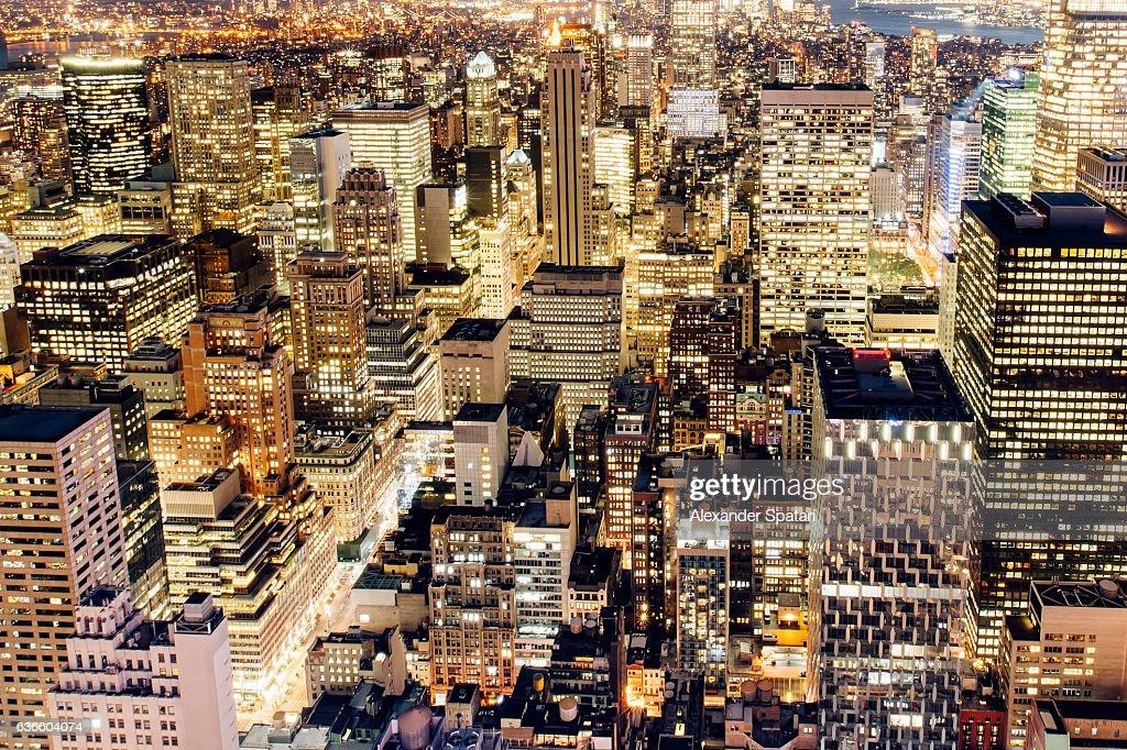 Illuminated skyscrapers of Manhattan at night, New York City, NY, USA : Stock Photo