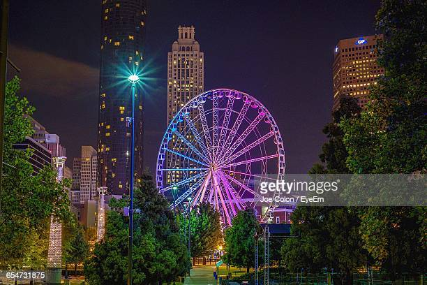 illuminated skyview atlanta at centennial olympic park - atlanta bildbanksfoton och bilder