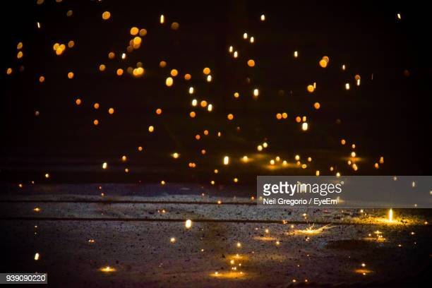 illuminated sparks against sky at night - sparks stock pictures, royalty-free photos & images