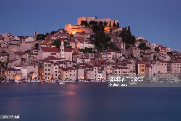 Illuminated St. Michael's Fortress and city buildings at dusk, Sibenik, Sibenik-Knin, Croatia
