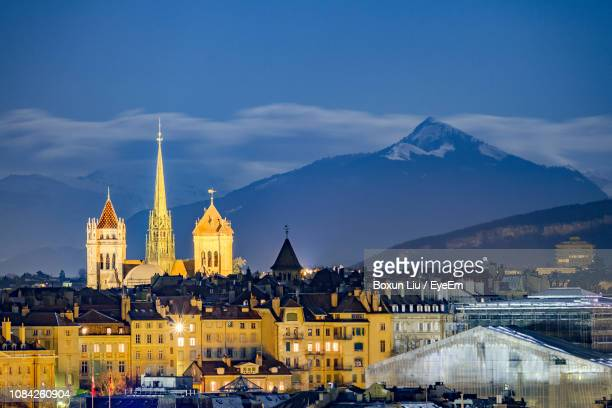 illuminated st pierre cathedral in town at dusk - geneva switzerland stock pictures, royalty-free photos & images