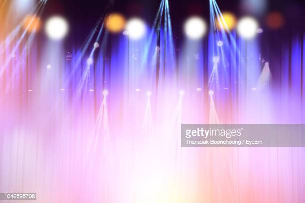 illuminated stage lights at night - stage light stock pictures, royalty-free photos & images