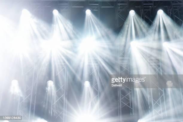 illuminated stage lights at night - スポットライトをあてる ストックフォトと画像