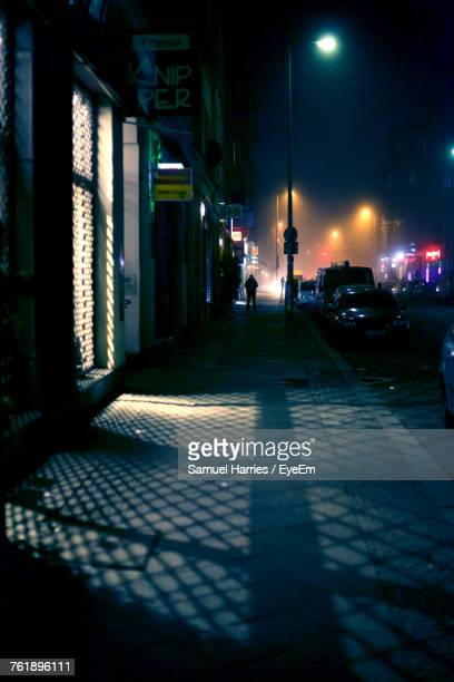 illuminated street at night - kreuzberg stock photos and pictures