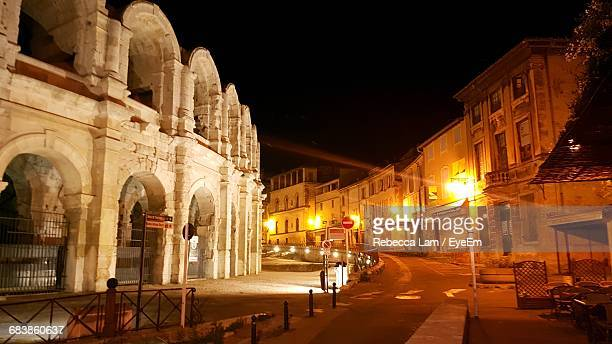 illuminated street by arles amphitheatre in city at night - bouches du rhone stock pictures, royalty-free photos & images