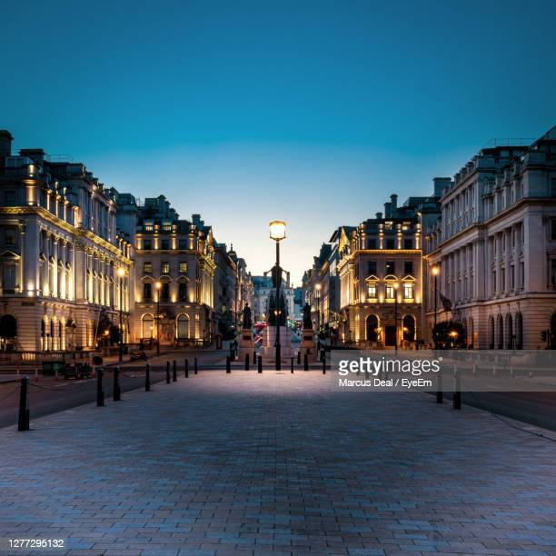 illuminated street in london at twilight - high street stock pictures, royalty-free photos & images
