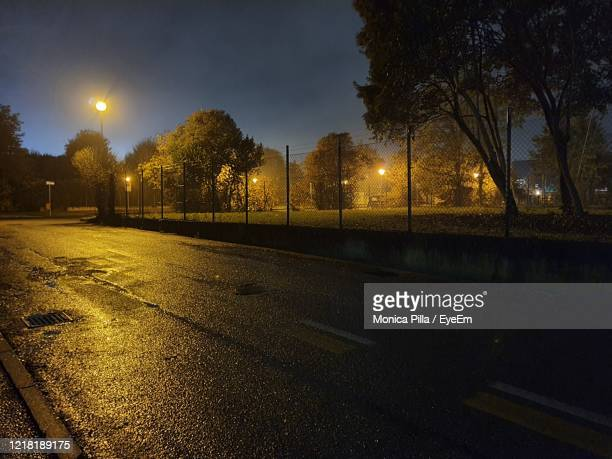 illuminated street lights at night - treviso italy stock pictures, royalty-free photos & images