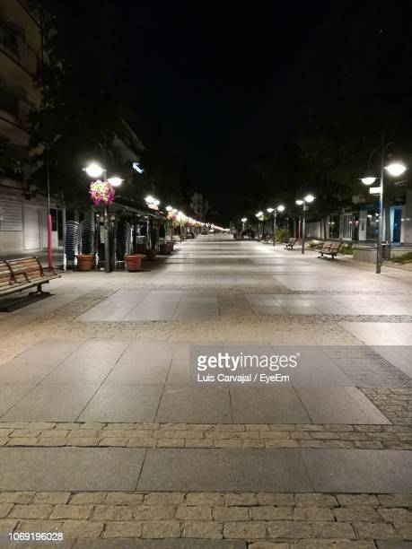 illuminated street lights in city at night - carvajal stock photos and pictures