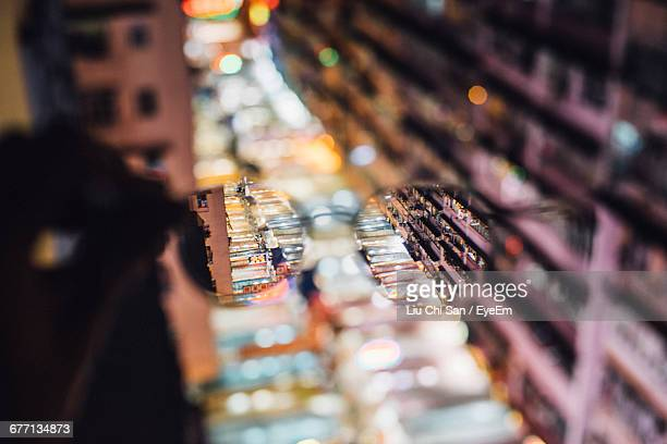 illuminated street market seen through eyeglasses - looking through an object stock pictures, royalty-free photos & images