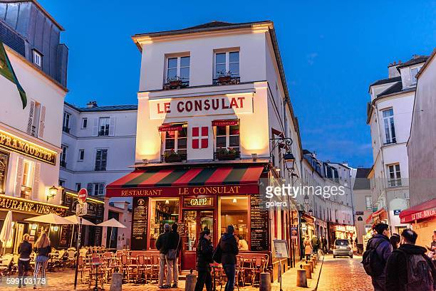 illuminated streets of Monmartre quarter in Paris at blue hour
