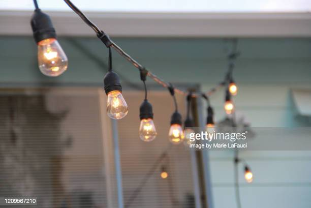 illuminated string lights - marie lafauci stock pictures, royalty-free photos & images
