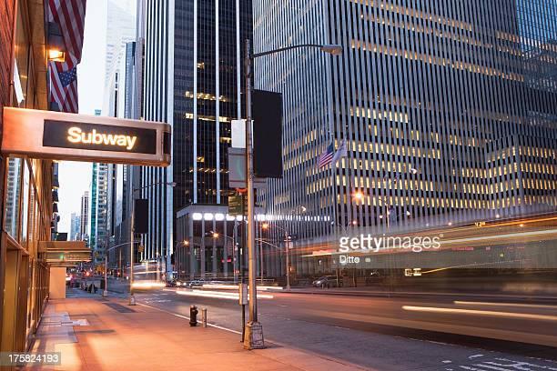 Illuminated subway sign at dusk, New York City, USA