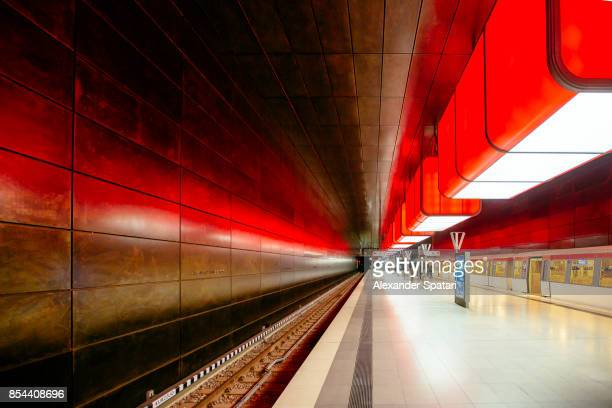 illuminated subway station in hamburg, germany - bahnhof stock-fotos und bilder