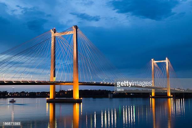 Illuminated suspension bridge at dusk