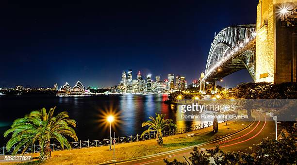 Illuminated Sydney Harbor Bridge Against Sky At Night
