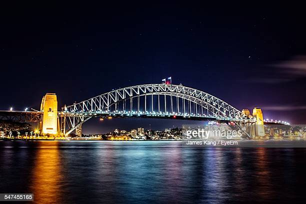 Illuminated Sydney Harbor Bridge Over River At Night