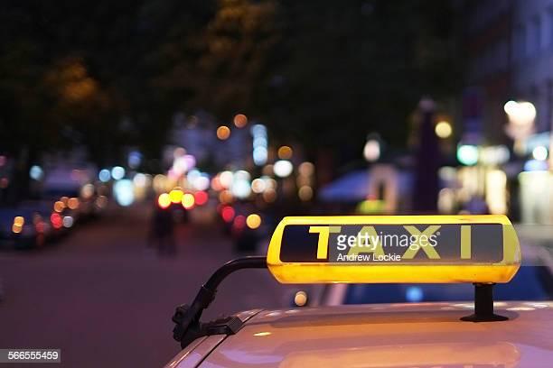 Illuminated taxi sign in Munich.