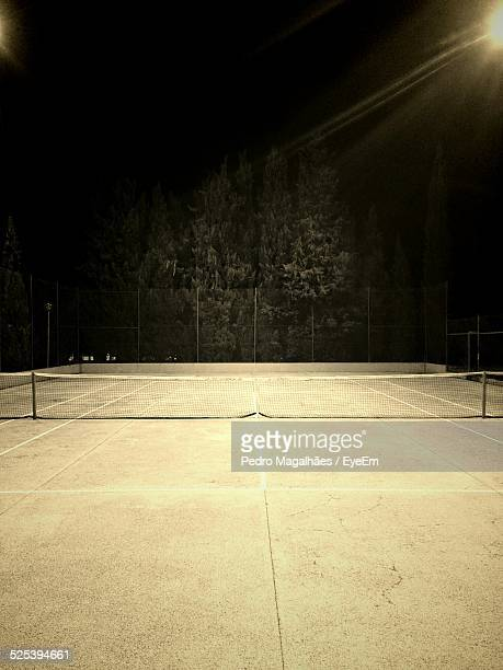 illuminated tennis court at night - floodlit stock pictures, royalty-free photos & images