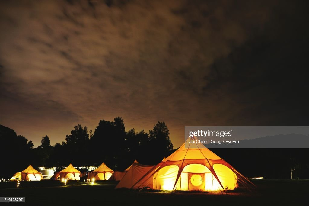 Illuminated Tent Against Sky At Night : Stock Photo