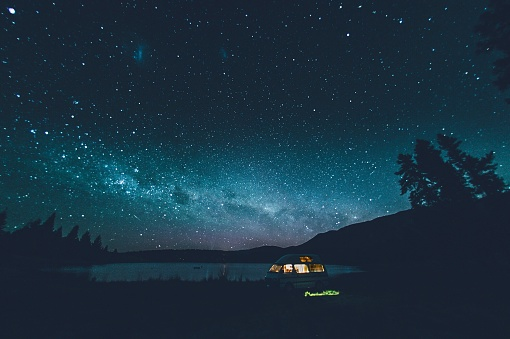 Illuminated Tent At Lake Against Sky At Night - gettyimageskorea