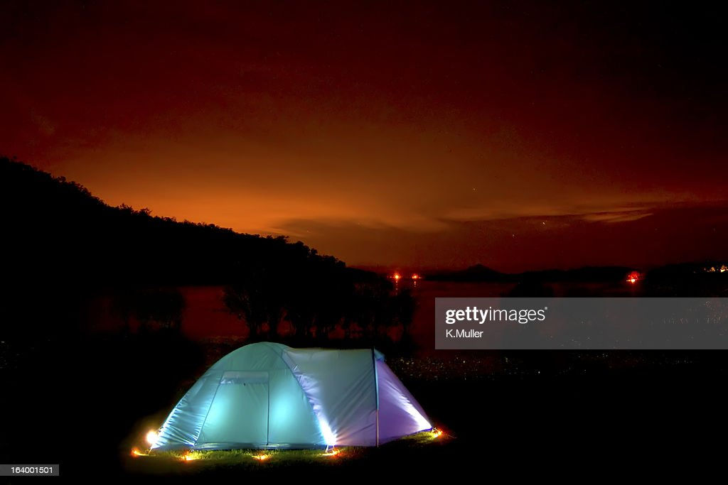 Illuminated Tent Under Dark Sky Sunset With Stars Stock Photo