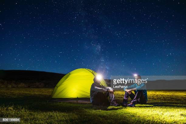 Illuminated tent under the stars at night