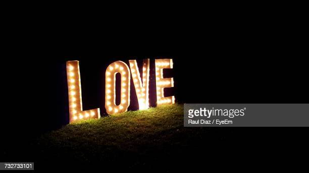 illuminated text at night - neon letters stock photos and pictures