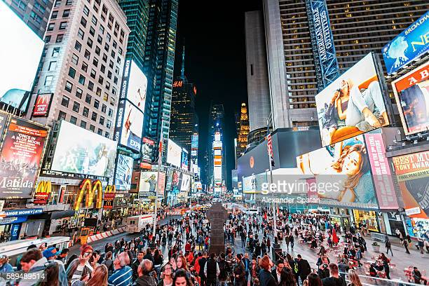 illuminated times square at night, new york city, ny, united states - broadway manhattan stock pictures, royalty-free photos & images