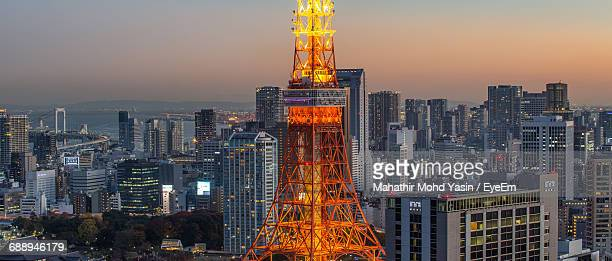 Illuminated Tokyo Tower Amidst City Against Clear Sky During Sunset
