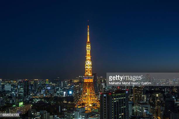 Illuminated Tokyo Tower And City Against Clear Sky At Night