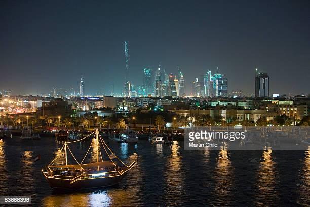 illuminated tourist dhow on Dubai Creek