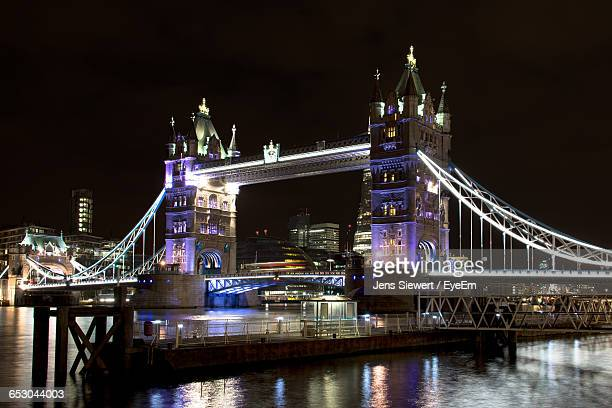 Illuminated Tower Bridge By River Thames At Night
