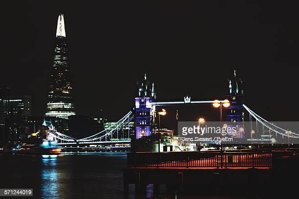Illuminated Tower Bridge Over River Thames By Shard Against Clear Sky At Night