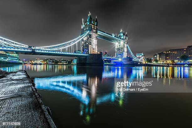 illuminated tower bridge over thames river in city at night - isolated color stock pictures, royalty-free photos & images