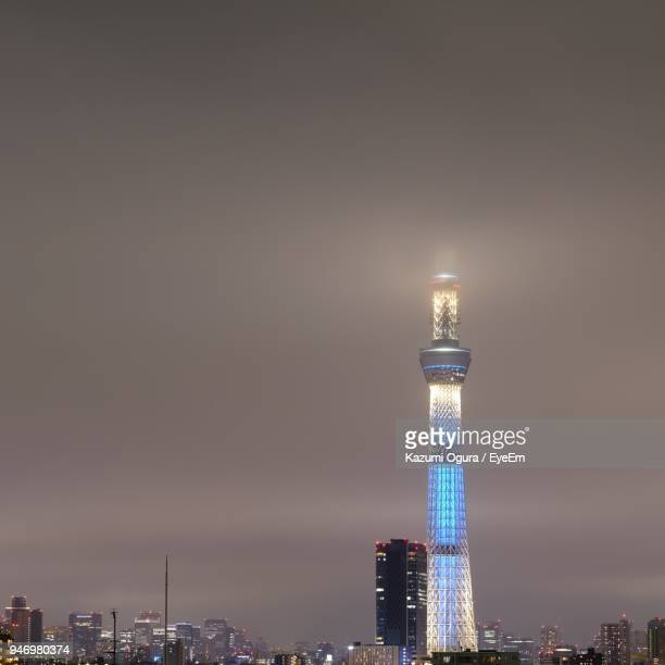 Illuminated Tower In City Against Sky At Night