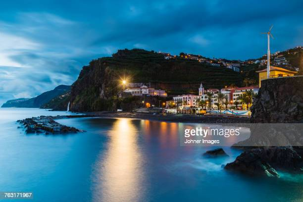 illuminated town at bay - madeira stock photos and pictures