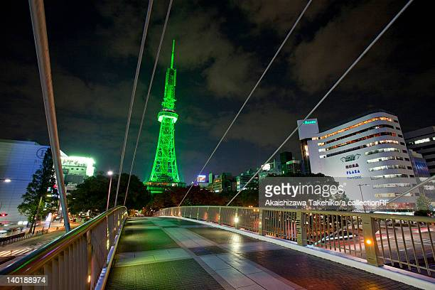 Illuminated TV Tower and Footbridge at the Central Park in Nagoya, Japan