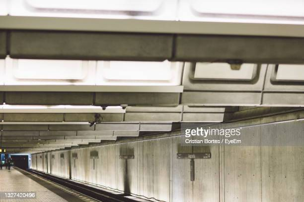 illuminated underground walkway - bortes stock pictures, royalty-free photos & images