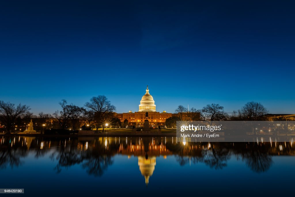 Illuminated United States Capital Dome With Reflection On River At Night : Stock Photo