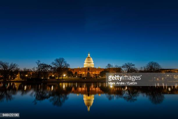 illuminated united states capital dome with reflection on river at night - capitol building washington dc stock pictures, royalty-free photos & images