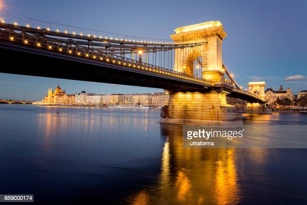 Illuminated view of Chain Bridge and Parliament in Budapest at night