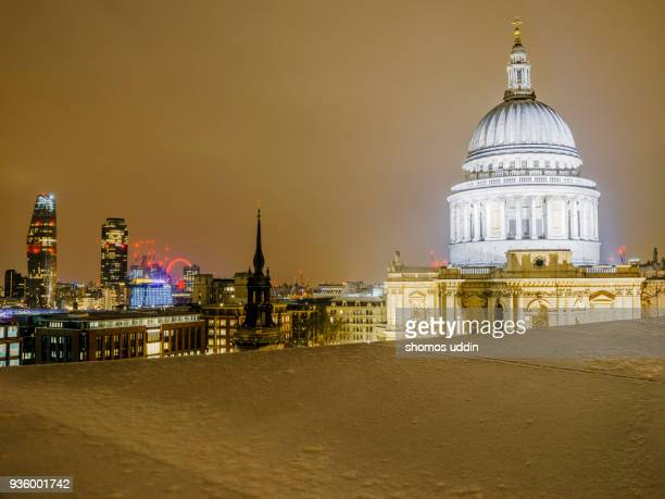 illuminated view of st paul's cathedral and the city skyline in winter snow - 2018 stock pictures, royalty-free photos & images