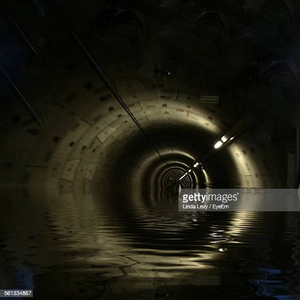 illuminated water tunnel - sewer stock pictures, royalty-free photos & images
