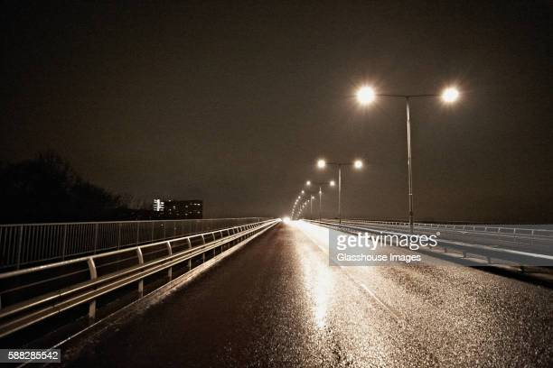 Illuminated Wet Urban Road at Night, Sweden