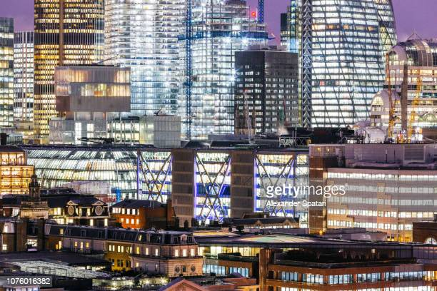 Illuminated windows at the office buildings on City of London at night