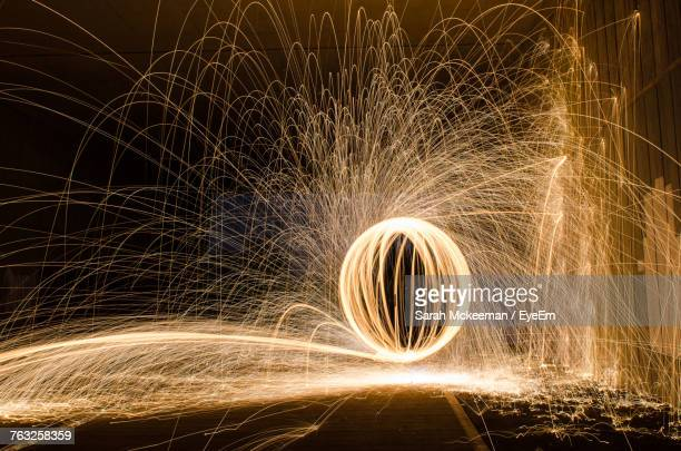 Illuminated Wire Wool Against Sky At Night