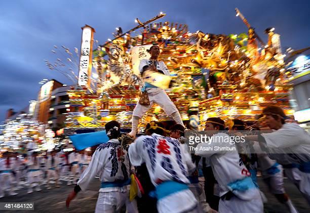 Illuminated 'Yamagasa' float runs at disbandment ceremony of the Kurosaki Gion Yamagasa Festival in front of JR Kurosaki Station on July 20 2015 in...