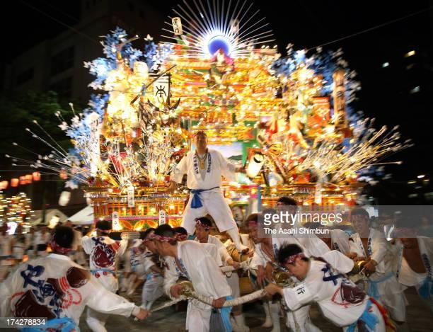 Illuminated 'Yamagasa' float runs during the Kurosaki Gion Yamagasa Festival at JR Kurosaki Station on July 19 2013 in Kitakyushu Fukuoka Japan The...